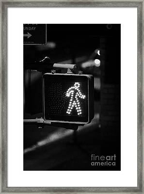 White Man Pedestrian Walk Sign Illuminated At Night New York City Usa Framed Print by Joe Fox