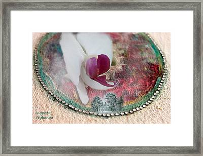 white Orchid on a Landscape Framed Print