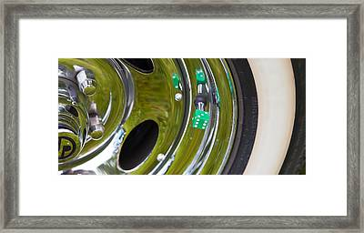 Framed Print featuring the photograph White Wall Tyre Chrome Rim And Dice by Mick Flynn
