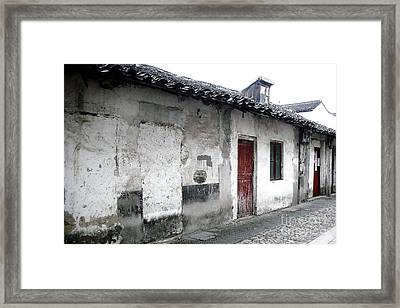 White Walls Red Doors Framed Print