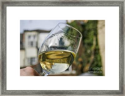 White Wine Swirling In A Glass Framed Print by Patricia Hofmeester