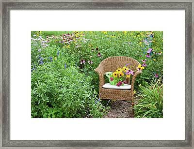 Wicker Chair With Basket And Birdhouse Framed Print by Panoramic Images