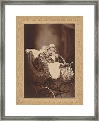 Framed Print featuring the photograph Wicker Pram by Paul Ashby Antique Image