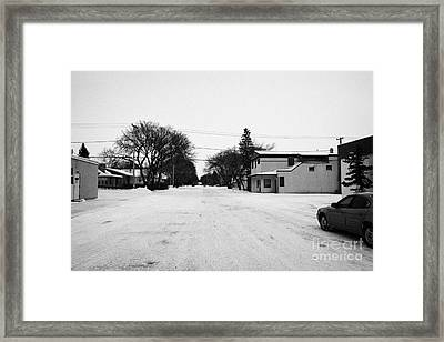 wide residential street in the small rural town of Kamsack Saskatchewan Canada Framed Print by Joe Fox