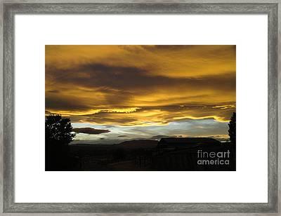 Wild Skies  Framed Print by Jeff Swan