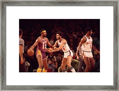Wilt Chamberlain Guarded By Kareem Abdul Jabbar Framed Print by Retro Images Archive