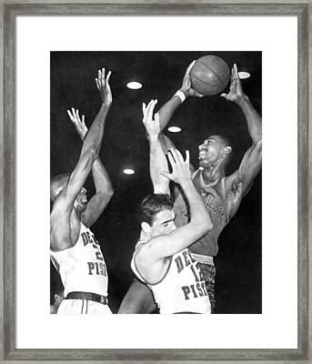 Wilt Chamberlain Shoots Framed Print by Underwood Archives