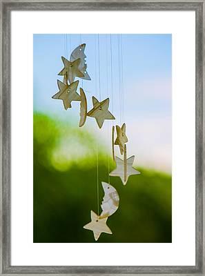 Wind Chimes Framed Print by Tommy Farnsworth