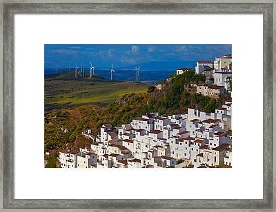 Wind Generators Beyond The Village Framed Print by Panoramic Images