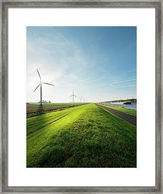 Wind Turbines And Canal, Bath, Zeeland Framed Print by Mischa Keijser