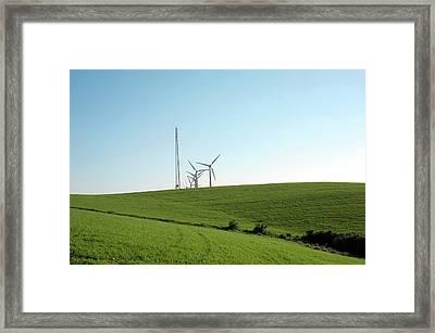 Wind Turbines And Pylon Framed Print by Jon Wilson