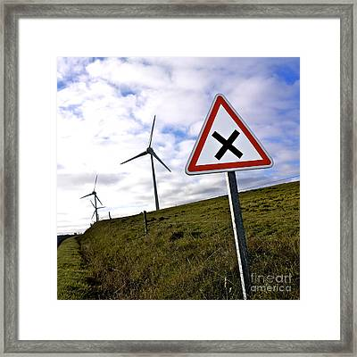 Wind Turbines On The Edge Of A Field With A Road Sign In Foreground. Framed Print by Bernard Jaubert