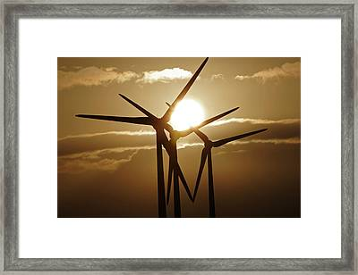 Wind Turbines Silhouette Against A Sunset Framed Print