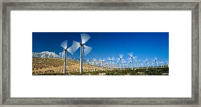 Wind Turbines Spinning In A Field, Palm Framed Print by Panoramic Images