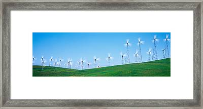 Wind Turbines Spinning On Hills Framed Print by Panoramic Images