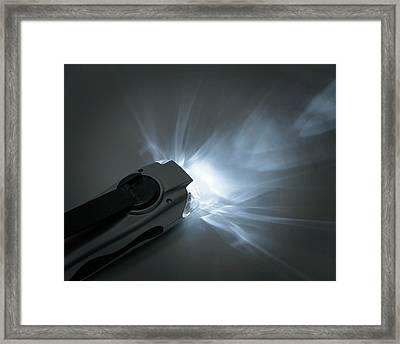 Wind-up Torch Framed Print by Robert Brook