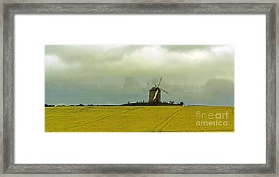 Windmill And Rapeseed And Storm Framed Print