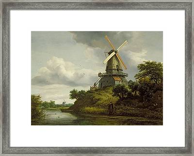 Windmill By A River Framed Print by Jacob Isaaksz or Isaacksz van Ruisdael