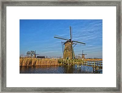 Windmills And Bridge Near Kinderdijk Framed Print