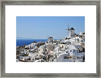 Windmills And White Houses In Oia Framed Print