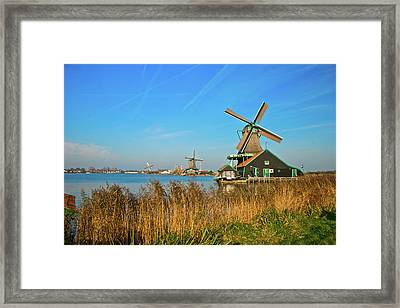 Framed Print featuring the photograph Windmills On De Zaan by Jonah  Anderson