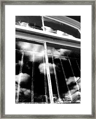 Window Clouds Framed Print