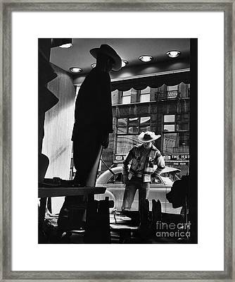 Window Shopping Cowboy Framed Print by Photo Researchers