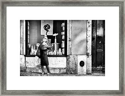 Window Shopping In Lisbon Framed Print by John Rizzuto
