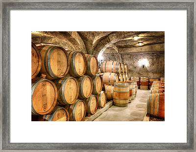 Wine Barrells In The Cellar Framed Print by Vicki Jauron