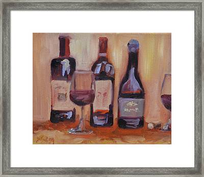 Wine Bottle Trio Framed Print by Donna Tuten