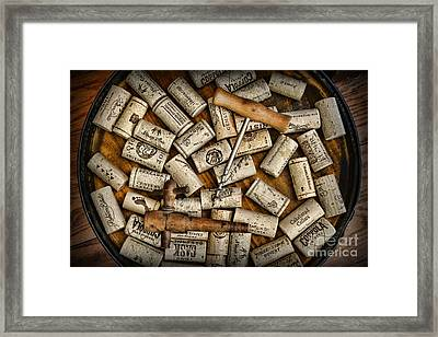 Wine Corks On A Wooden Barrel Framed Print