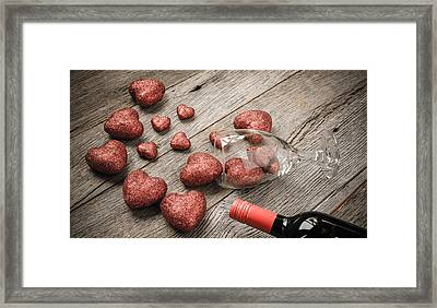 Wine Glass And Wine With Red Hearts On Valentines Day Framed Print by Brandon Bourdages