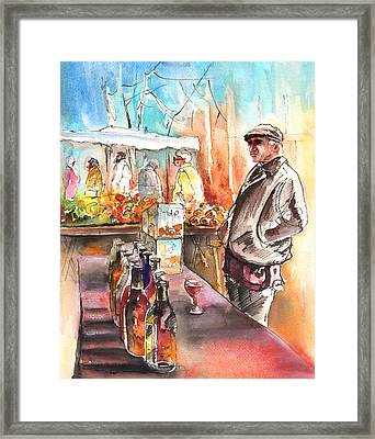 Wine Vendor In A Provence Market Framed Print by Miki De Goodaboom