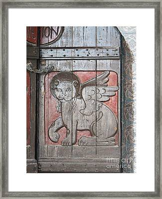 Winged Lion Of Saint Mark On Old Wooden Door In Crete Greece Framed Print by Cimorene Photography