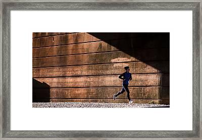 Winning Shadow Framed Print by Geoffrey Baker