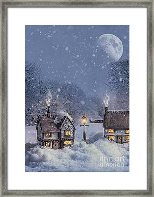 Winter Cottages Framed Print by Amanda Elwell