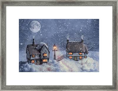 Winter Cottages In Snow Framed Print by Amanda Elwell