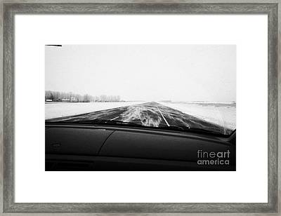winter driving along Saskatchewan highway 11 from Saskatoon to Regina with cracked windscreen and wi Framed Print by Joe Fox