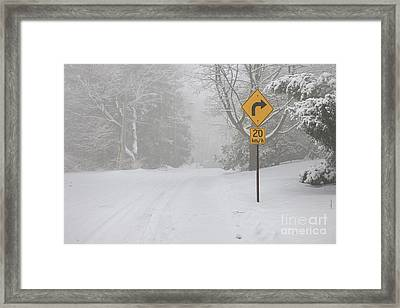 Winter Road With Yellow Sign Framed Print by Elena Elisseeva