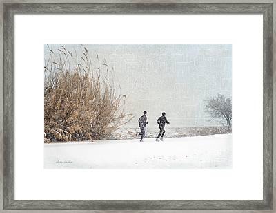 Winter Runners Framed Print by Betty LaRue