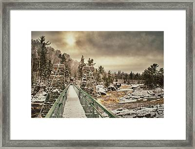 Winter Sunrise Over A Swinging Bridge Framed Print