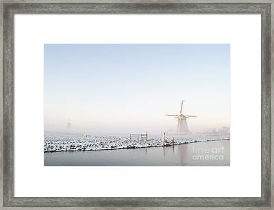Winter Windmill Landscape In Holland Framed Print by IPics Photography