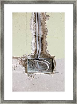 Wiring A Socket Into A House Wall Framed Print by Ashley Cooper