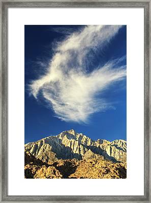 Wispy White Clouds And Dark Blue Sky Framed Print by James White