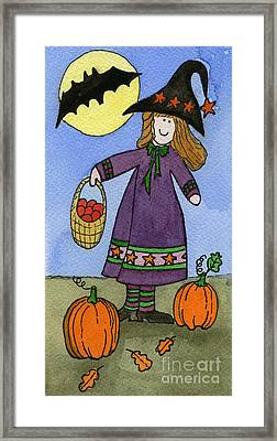 Witch And Pumpkins Framed Print