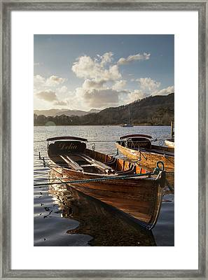 Woden Boats Tied At The Water S Edge Framed Print by John Short