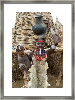 Woman And Child Of The Dassenech Tribe Framed Print by Peter J. Raymond