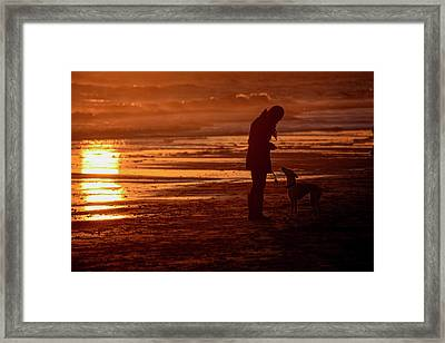Woman And Dog  On The Beach  At Sunset Framed Print