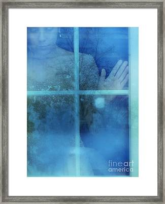 Woman At A Window Framed Print