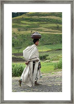 Woman Balancing Lunchbox On Her Head Framed Print